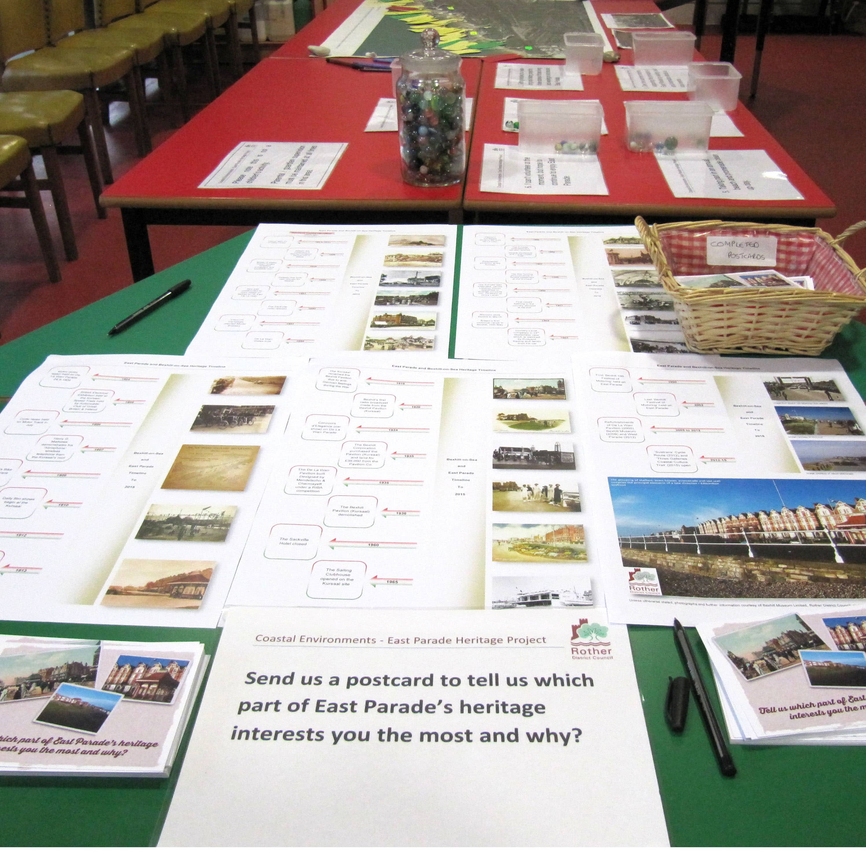 Table with boards and images and text on, asking people to provide feedback.